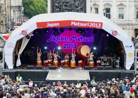 London, England - October 5, 2013  Japanese matsuri festival showing taiko drummers on stage and crowd of people