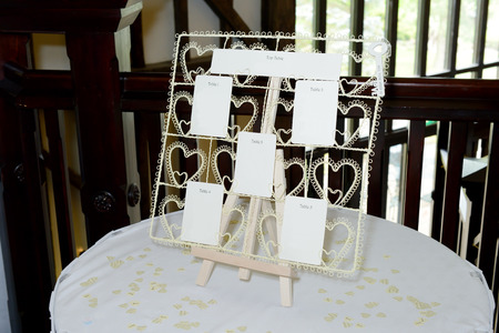 Wedding reception seating plan closeup on table with decoration Standard-Bild