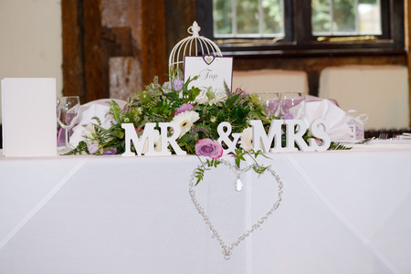mr and mrs: Mr & Mrs decoration at wedding reception with detail of heart and jewels