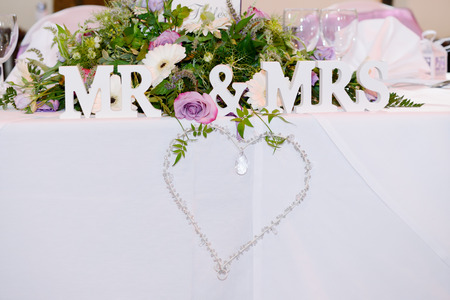 mr and mrs: Decoration at wedding reception is heart shape with mr & mrs