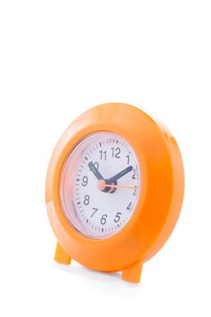 orange alarm clock isolated on white
