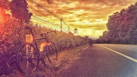 Road bike on hill - Stock image Imagens