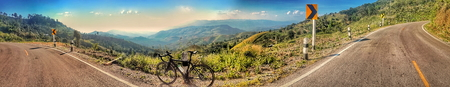 riding a bicycle on hill. doi chang, chiang rai, thailand Imagens