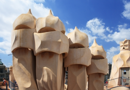 BARCELONA - AUGUST 31: Casa Mila La Pedrera building roof and chimneys on August 31, 2010 in Barcelona. Casa Mila is one of buildings created by Antonio Gaudi.