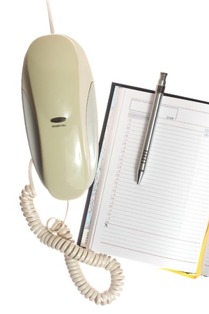Notebook, phone and pen isolated over white