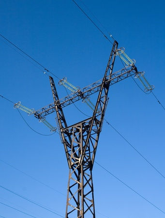 isolator insulator: High voltage line mast Stock Photo