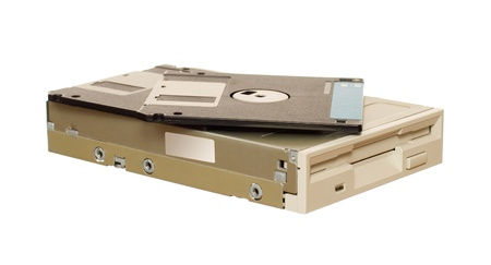dataset: Floppy disk drive with diskettes isolated over white Stock Photo