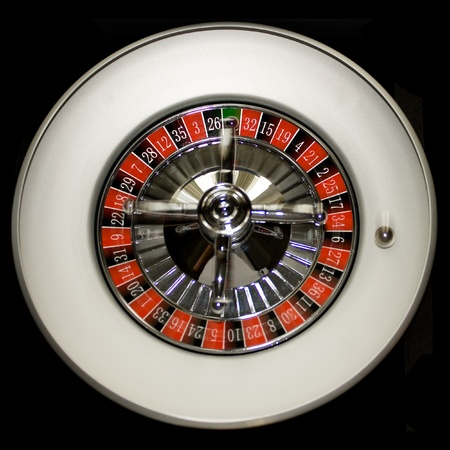 Ball is rolling on a roulette wheel photo