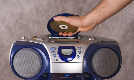 Inserting a disk into CD player Stock Photo - 12954278