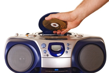 Inserting a disk into CD player Stock Photo
