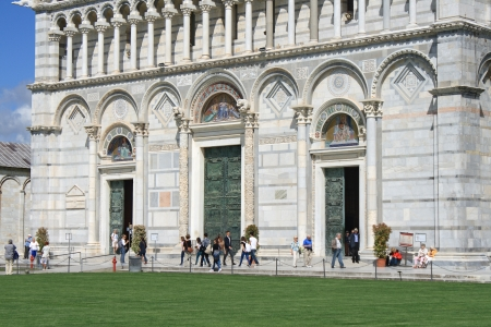 PISA - MAY 04  View of Duomo  cathedral  entrance on May 04, 2012 in Pisa  Duomo is at the Piazza dei miracoli which is the most attractive destinations of Pisa   Editorial