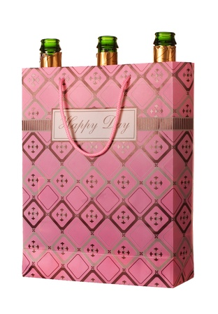Empty champagne bottles in a bag with Happy Day writing isolated on white
