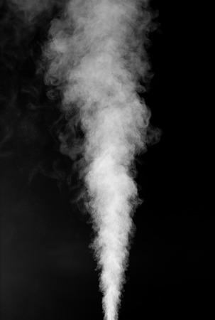 White vapor on the black background