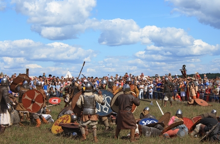DRAKINO, RUSSIA - AUGUST 23: Medieval battle reconstruction Voinovo Pole (Warriors Field) on August 23, 2014 near Drakino, Russia. This amateur performance attracts people due to the show and free accsess.