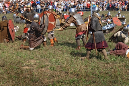 DRAKINO, RUSSIA - AUGUST 23: Free Medieval battle show Voinovo Pole (Warriors Field) on August 23, 2014 near Drakino, Russia. This amateur performance attracts people due to show and free accsess. Editorial