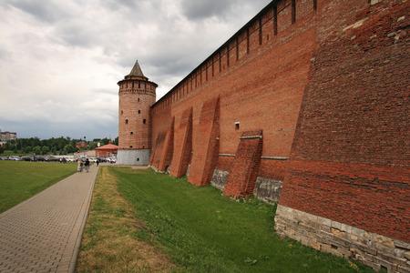 People walk by old walls of Kolomna Kremlin. The kremlin was built in the 16th century and is te popular landmark of Russia.