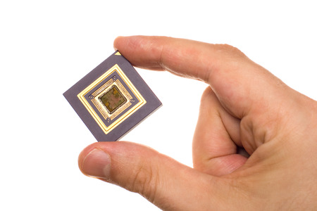 Microprocessor in hand isolated on white
