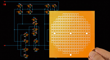microprocessors: Chip mask in hand over circuit schematic diagram Stock Photo