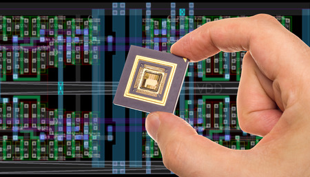 floorplan: Microprocessor in hand in front of chip layout