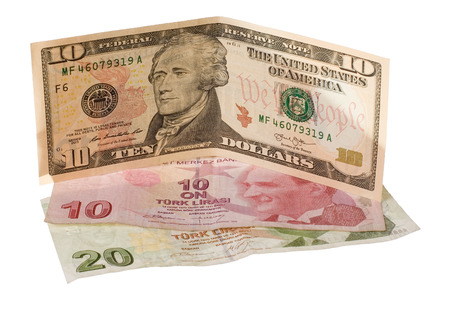 finacial: Finacial crisis: new ten dollars over thirty crumpled turkish liras. Isolated on white.