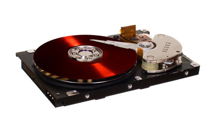 Hard disk drive with red vinyl disk instead of magnetic plate isolated on white background