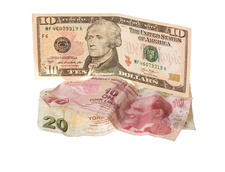 turkish lira: Financial crisis: new ten dollars over thirty crumpled turkish lira. Isolated on white.