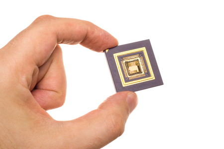 microprocessors: Microprocessor in hand isolated on white