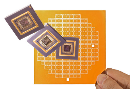 microprocessor: Microprocessor and chip mask in hand isolated on white