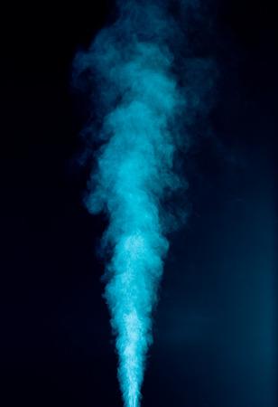 Blue vapor on the black background