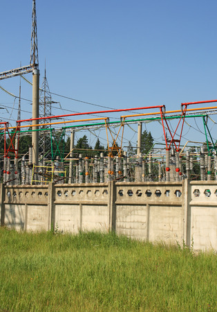 Electrical power high voltage substation encircled with barbed wire fence Stock Photo