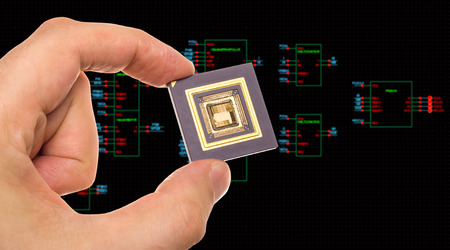 microprocessor: Microprocessor in hand over circuit schematic diagram Stock Photo