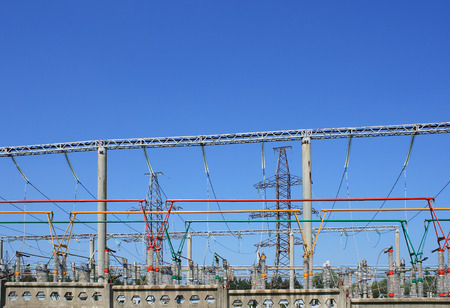 sub station: Electrical power high voltage substation encircled with barbed wire fence Stock Photo