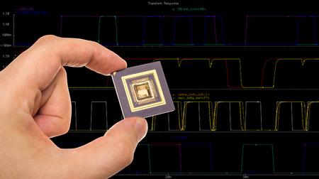microprocessor: Microprocessor in hand and signals plots Stock Photo