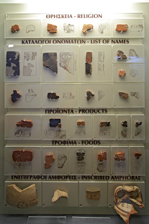 Mycenae, Greece, September, 07, 2016. Clay plates with Mycenaean script in museum of Mycenae. These artefacts were created about 3500 years ago.
