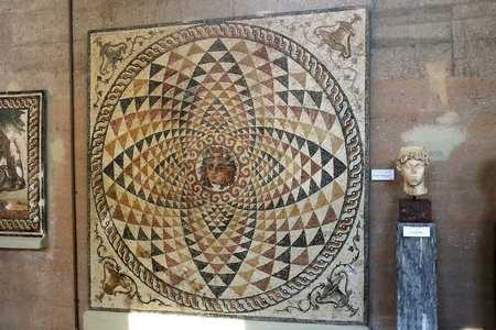 Ancient Corinth, Greece, September, 02, 2016. Mosaic in the museum. The mosaic from roman villa was created more than 2000 years ago.