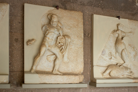 Ancient Corinth, Greece, September, 02, 2016. Bas-relief of Hercules in the museum. The relief was created more than 2000 years ago. Editorial