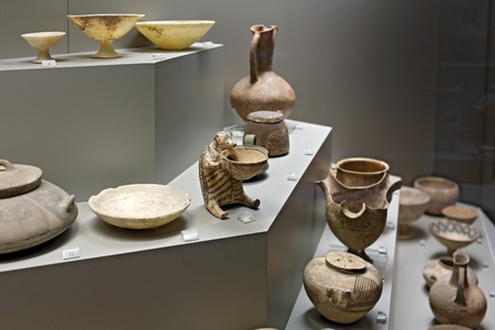 Athens, Greece, September, 03, 2016. Cycladic pottery in museum of archaeology, Athens, Greece. These art objects were created about 5000 years ago.