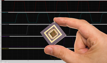 Microprocessor in hand and signals plots Stock Photo
