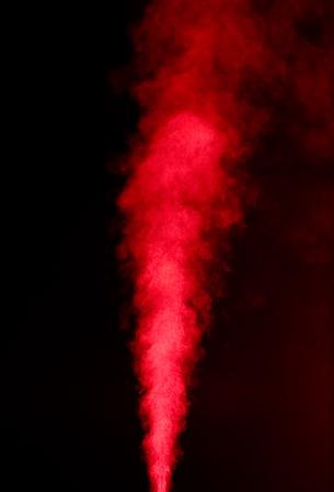 Red vapor on black background