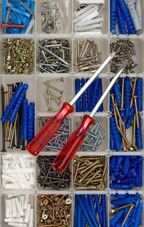 Screwdrivers, screws and dowels Stock Photo