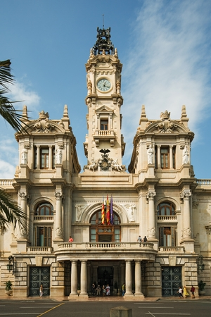 Valencia, Spain - September, 12, 2018. Tourists visit Valencia Ajuntament (City Hall). The baroque building is one of the main historical landmarks of the city