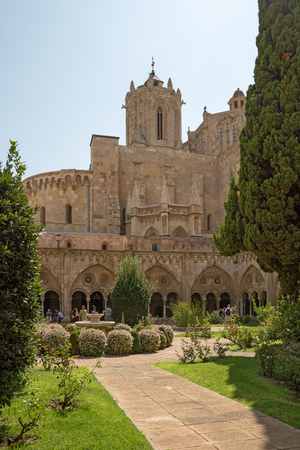 Tarragona, Spain - September, 06, 2018. People walk within cloister of Tarragona cathedral. This church is the main medieval landmark of the city.