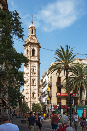 Valencia, Spain - September, 12, 2018. People walk by the church of Saint Catherine (Santa Caterina). The church has unusual decoration of gun barrels - which make in the popular historical landmark of the city Editorial
