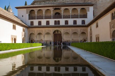 Granada, Spain - May, 4, 2019. Patio of Nasrid moresque palace of Alhambra. The palace is UNESCO World Heritage and the official number one travel destination of Spain. Editorial