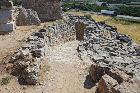 Ruins of ancient acropolis of Tiryns - a Mycenaean archaeological site in Argolis in the Peloponnese, and the location from which mythical hero Heracles performed his 12 labors, Greece.