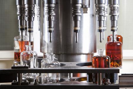 Bottle filling machine filling the bottles with liquor Stock Photo