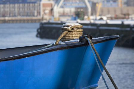 stow: Bow of a blue ship moored in harbor Stock Photo