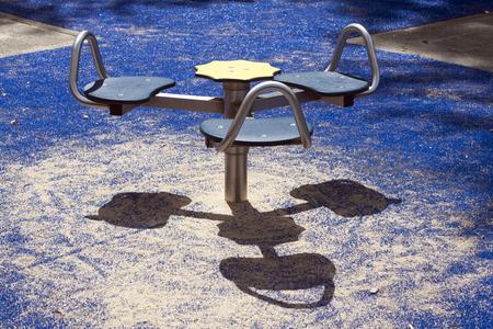 children playground: Carousel in a children playground with smiling shadow