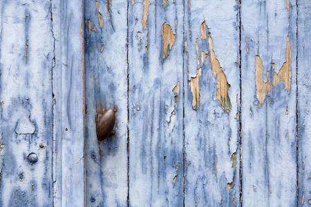wooden color: Blue peeling paint door background Stock Photo