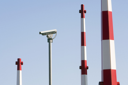 barriers: Security camera and barriers of a security system Stock Photo